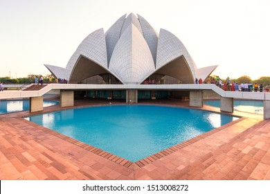 Delhi / India - September 19, 2019: Tourists visiting the Lotus Temple, a Bahai House of Worship in New Delhi, India