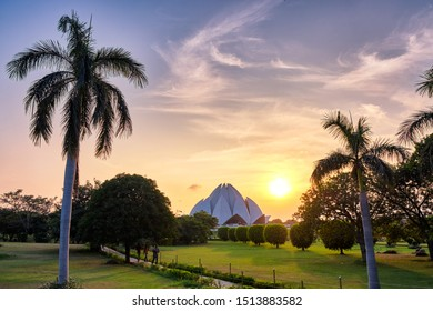 Delhi / India - September 19, 2019: Sunset over the Lotus Temple, a Bahai House of Worship in New Delhi, India