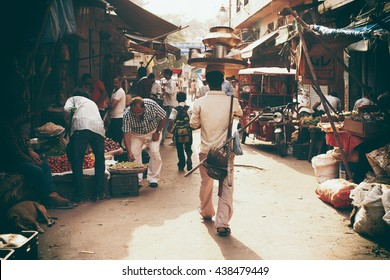 Delhi, India - September 21, 2015: Fruit and Vegetable Market. man with dishes on the head