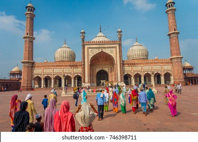Delhi, India - September 27, 2017: Unidentified indian tourists visiting Jama Masjid, in Delhi, India. Jama Masjid is the largest and perhaps the most magnificent mosque in India