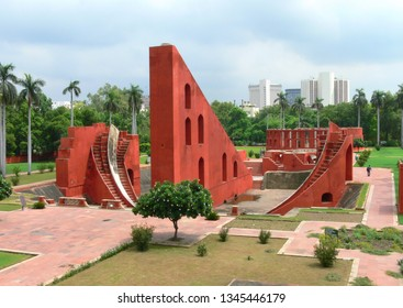 Delhi, India-01/20/2017. Centuries old architecture at the historical astronomical observatory Jantar Mantar, Delhi, India contrasting with the modern architecture in the background skyline
