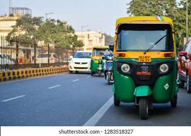 Delhi, India,2019. Emphatic looking CNG fueled autorickshaw, standing on the corner of the road, is a popular urban transportation on Indian roads, Mumbai, Pune, Lucknow, Jaipur, Hyderabad, Bangalore.