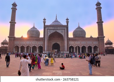 DELHI, INDIA-NOVEMBER 5: Unidentified people walk in courtyard of Jama Masjid at sunset on November 5, 2014 in Delhi, India. The courtyard of the mosque can hold up to twenty-five thousand worshippers