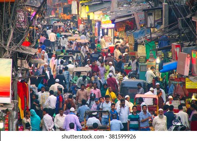 DELHI, INDIA-NOVEMBER 5: Unidentified people walk on Chawri Bazar in the evening on November 5, 2014 in Delhi, India. Chawri Bazar is a specialized wholesale market of brass, copper and paper products