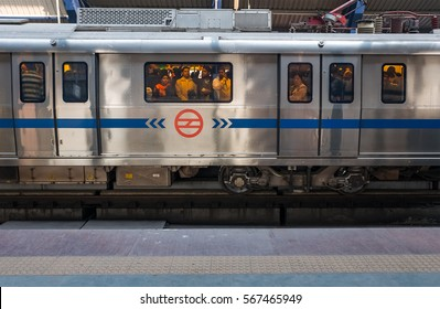 DELHI - JAN 3: Passengers taking the metro on 3 January 2016 in Delhi, India. Delhi Metro is the world's 12th largest metro system in terms of both length and number of stations.