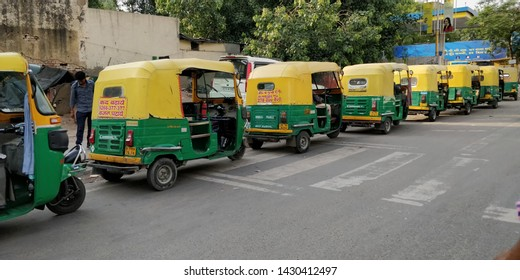 Delhi/India- 06 21 19: a set of autorickshaw standing in line outside new Delhi railway station waiting for customers. auto rickshaw standing next to petrol pump station to fill CNG or petro