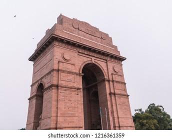 Delhi/India - June 2018: Full side angle of India gate at sunrise