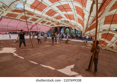 Delhi/India - May,25th,2018 : Boys hold the supporting polls of the temporary tent during a wind storm right before the Jummah Prayer ( Friday Namaz) at Jama Masjid in Delhi, India.
