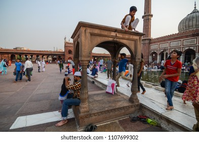 Delhi/India - May,25th,2018 : Kids playing in the courtyard of Jama Masjid during the month of Ramadan in Delhi, India.