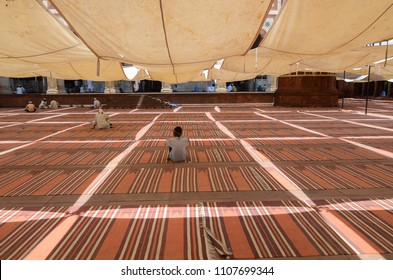 Delhi/India - May,25th,2018 :  A man sitting under the temporary tent at Jama Masjid waiting for the Jummah Namaz (Friday prayer).