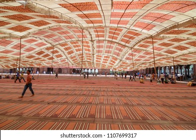 Delhi/India - May,25th,2018 :  Temporary tents fly in the air during a wind storm right before the Jummah Namaz (Friday prayer) at Jama masjid in Delhi, India.