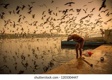 Delhi,November 21 2017, An unidentified man taking a bath at the Ghat Number 24, Yamuna River, Delhi, India.