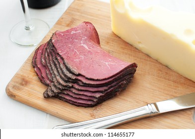 Deli meat and cheese on cutting board horizontal