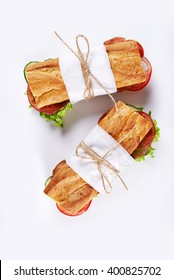 deli sandwiches in paper wrap /top view