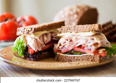 Deli style sandwich stacked with sliced roast turkey, fresh tomatoes, Jarlsberg cheese, green leafy lettuce, Spanish onions, sweet oat & wheat bread with a dijon ranch dressing.