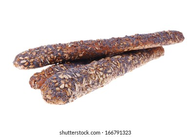 delicacy french rye bread baguette topped with sunflower and poppy seeds isolated over white background