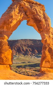 Delicate Arch scenery, under warm evening light, profiled on clear blue sky