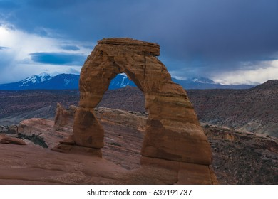 Delicate arch in Utah's Arches national Park, beneath a stormy sky