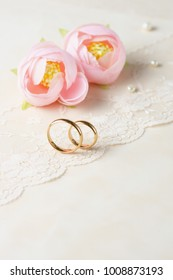Delicate background with wedding rings.