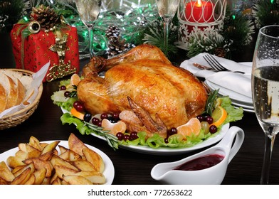 Delicate baked chicken   with an appetizing crust with a citrus garnish on the Christmas table