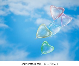 Delicate balloons-heart on blue sky background. The concept of ease of relationship, love, Valentine's Day
