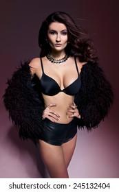 delicate brunette woman in a fur