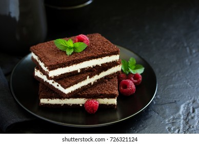 Delicate chocolate creamy cake with raspberries.