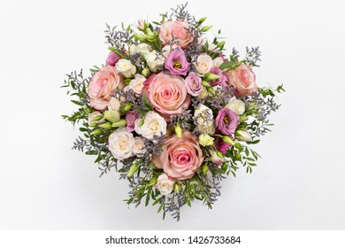 delicate floral arrangement of roses and live decorations in a square cardboard box (primary color - pink) on a light background