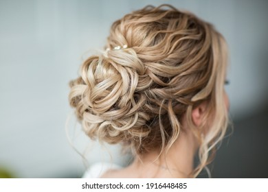 delicate hairstyle of the bride with decoration