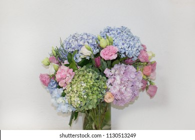 delicate hydrangeas closeup. a bouquet of hydrangeas is in a vase. floral background with hydrangeas.