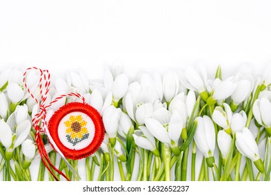 delicate snowdrops on white with  martisor symbol 1st of march celebration concept
