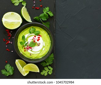 Delicate soup with avocado, with lime and cilantro.