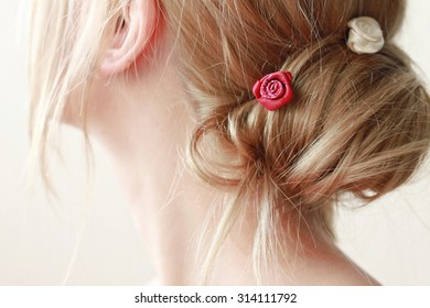 Delicate woman no-face blond hair bun very soft tender focus