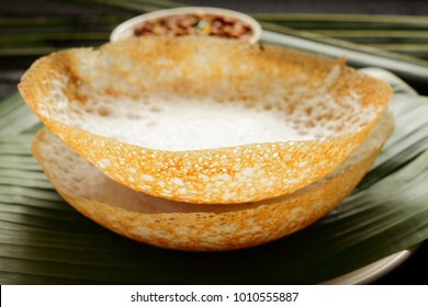 Delicious appam served with chickpeas curry