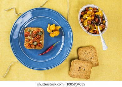 Delicious appetiser roasted tomato with chilli pepper and toast