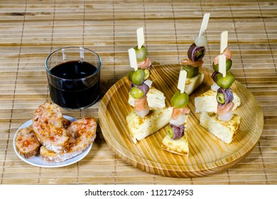 Delicious Appetizer Plate with Salmon, anchovies  and Olives. Spanish tortilla mounted