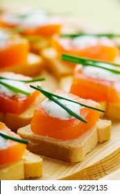 Delicious appetizers with smoked salmon and dill sauce