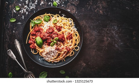 delicious appetizing classic spaghetti pasta with parmesan and fresh basil