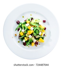 Delicious and appetizing salad with avocado, cheese and lettuce in a white plate isolated on white background, top view, flat, overhead. Autumn menu in an Italian restaurant. Photo for menu design