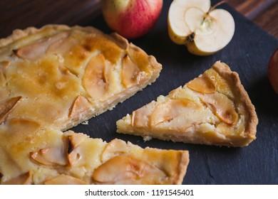 Delicious apple autumn pie on a dark background