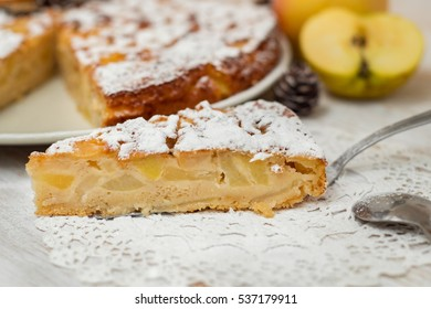 delicious apple pie with cinnamon over white wood background. holiday cooking concept