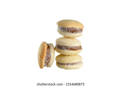 Delicious Argentinian cookies alfajores with cream dulce de leche close-up isolated. White vanilla macaroons on white background. French delicate dessert for Breakfast.