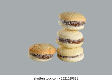 Delicious Argentinian cookies alfajores with cream dulce de leche close-up isolated. White vanilla macaroons on gray background. French delicate dessert for Breakfast .