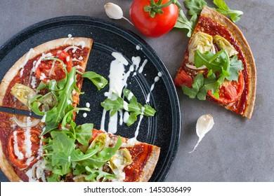 Delicious Artichoke marinara sauce pizza.