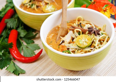 Delicious Asian noodles on bamboo mat with focus pointed in front of dish and shallow DOF