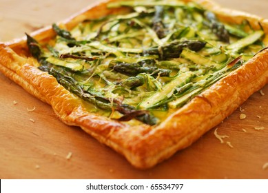 Delicious asparagus ribbon tart cooling on a bench.