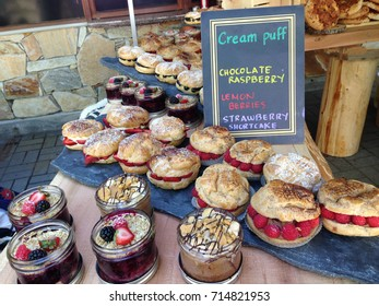 A delicious assortment of desserts including cream puffs, strawberry shortcake and chocolate with berries parfaits on display at the Whistler Mountain Resort Farmers' Market in