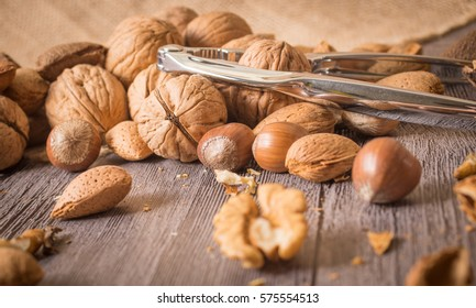 Delicious assortment of nuts on wooden background