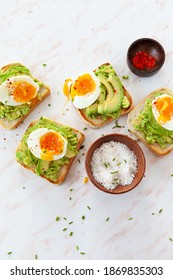 Delicious avocado toast with soft boiled eggs