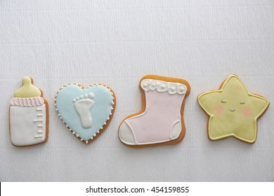 Delicious baby shower cookies on table